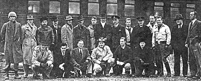 Photo: Some of the aircrew from the first Hudson deliveries. Standing: W.B. Lyons; D.L. Gentry; R. Adams; C.M. Tripp; W.C. Rodgers; J.A. Webber; J.D. McIntyre; S.T.B. Cripps; N.G. Mullett; A.M. Loughridge; A. Andrew; N.E. Smith; G.R. Hutchison; J.W. Gray; D.C.T. Bennett. Kneeling: D.B. Jarvis; H.G. Meyers; J.E. Giles; E.F. Clausewitz; K. Garden; W.T. Mellor.